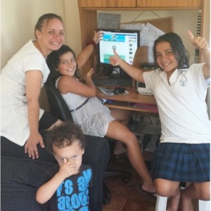 An East Coast family celebrates having digital skills, a computer and the