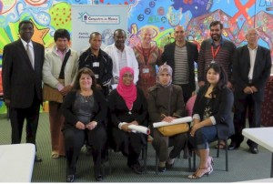 CiH graduates at the RYAN Centre (Refugee Youth Action Network). The amazing multi-cultural mural backdrop was created by the youth