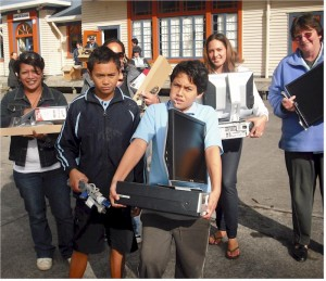 Graduate families collect computers from their school