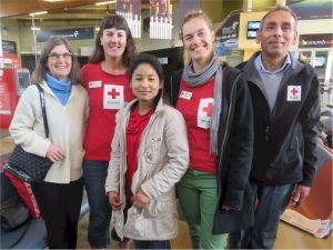 Chandra Dahal is now employed by Red Cross and is seen here at Nelson airport with the welcome team, August 2016